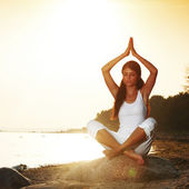 Ocean yoga sunrise — Stock Photo