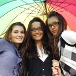 Smiling girlfriends under umbrella — Stock Photo #6669813