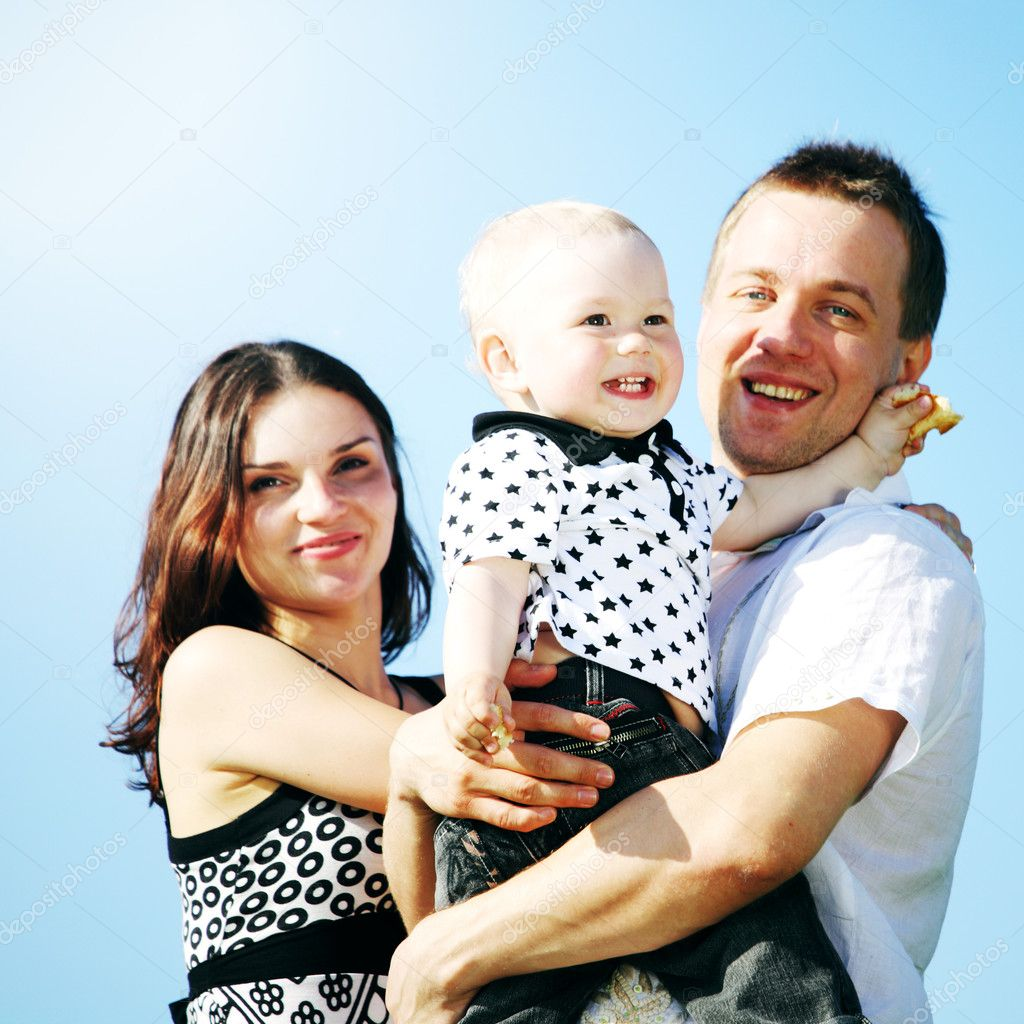 Happy family on blue sky background — Stock Photo #6669103
