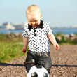 Boy play soccer - Stock Photo