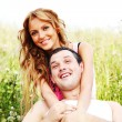 Lovers on grass field — Stock Photo #6699987