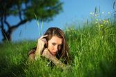 Brunette on grass — Stock Photo