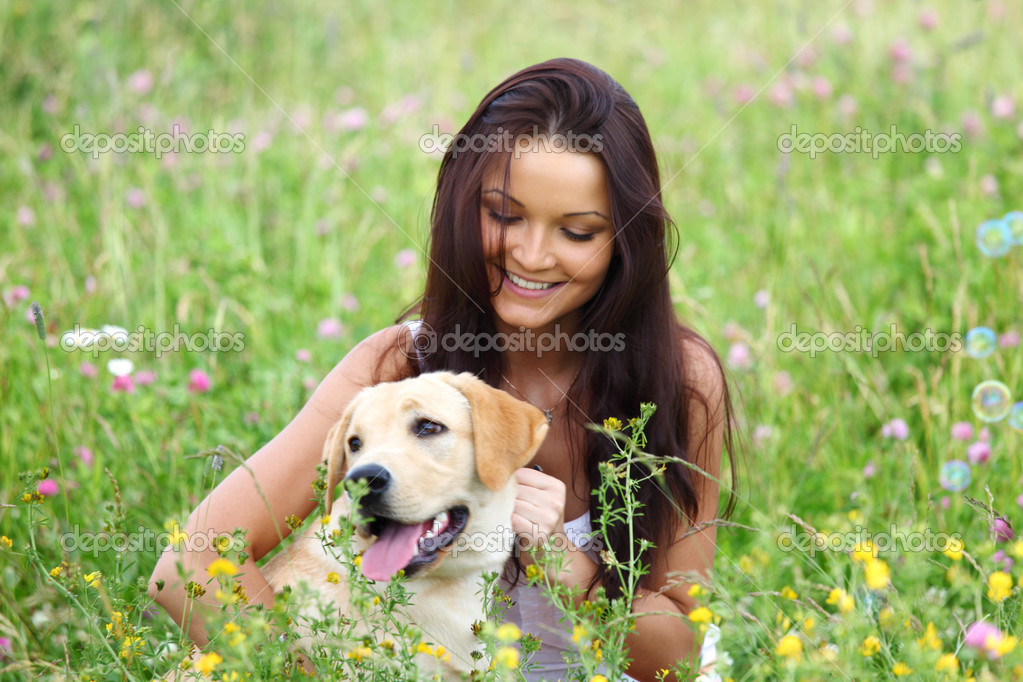 Woman and she lablador dog in green grass — Stock Photo #6693974