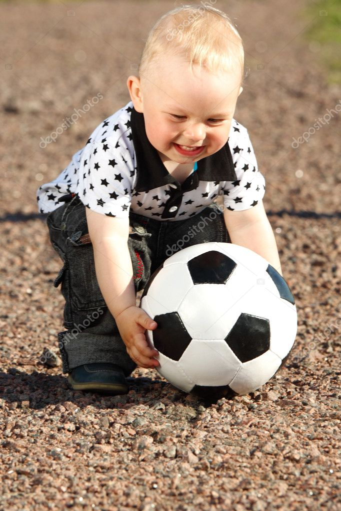 Little boy play soccer outdoor  Stock Photo #6699338