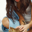 Waking woman and cat — Stock Photo