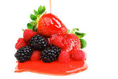 Big berry pile in syrup — Stock Photo