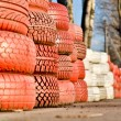 Racetrack fence of white and red of old tires — Stock Photo
