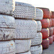 Racetrack fence of white and red of old tires — Stock Photo #5517233
