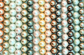 A lot of pearl beads close up — Stock Photo
