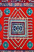 Colored wool handmade carpet closeup — Stock Photo