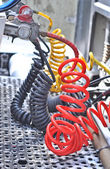 Colorful Pneumatic hoses between the truck and trailer — Stock Photo