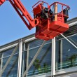 Red hydraulic construction cradle against the blue sky — Stock Photo