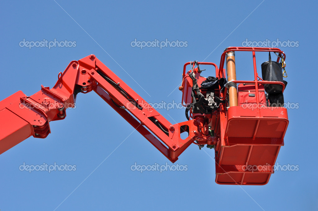 Red hydraulic construction cradle against the blue sky  Stock Photo #5813653