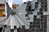 A stack of aluminum structural profiles — Stock Photo