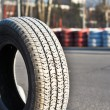 Stock Photo: Old tires on asphalt of race track.JPG