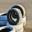 Old tires on the asphalt of a race track.JPG — Stock Photo