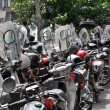 Stock Photo: Lot of mopeds parked Tehran, Iran