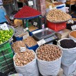 Stock Photo: Spices and nuts on scales and dishes in old bazaar in Tehran, Iran