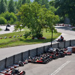 Stock Photo: Go kart racing on circuit