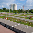 Outdoor winding asphalt karting track in city boundaries — Stock Photo