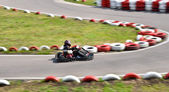 Go kart racing on circuit blurry — Stock Photo