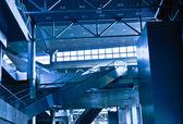 Interior of the contemporary business-center with escalators — Stock Photo