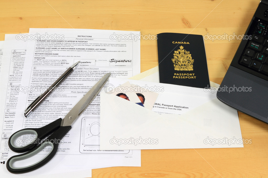 Picture of all objects (application form, passport pictures, mail envelope and expired passport) used to apply for Canadian passport renewal by mail.   Stock Photo #5731639