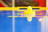 Yellow air hockey mallet — Stock fotografie