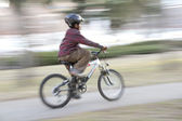 Young boy riding a bike — Stock Photo