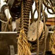 Stock Photo: Old rope and wooden block pulleys