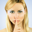 Beautiful girl holding finger on lips — Stock Photo #6370307