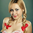 Stock Photo: Cute girl with plaits
