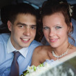 Portrait of newlywed couple in car — Stockfoto #5738948