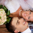 Newlywed couple lying together on the bed — Stock Photo