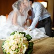 Newlywed couple kissing each other in the bedroom — Stock Photo