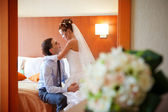 Newlywed couple romancing in the bedroom — Stock Photo