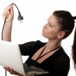 Young woman netbook powercable — Stock Photo