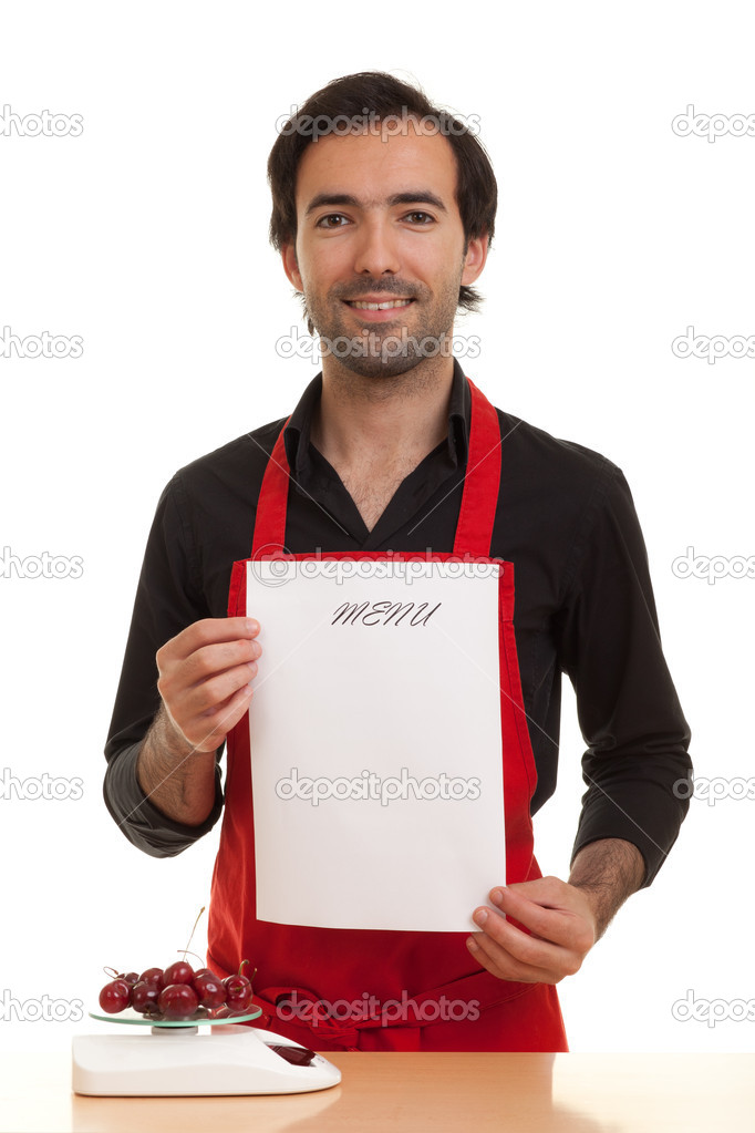 A chef holding an empty menu in front of him — Stock Photo #5916101