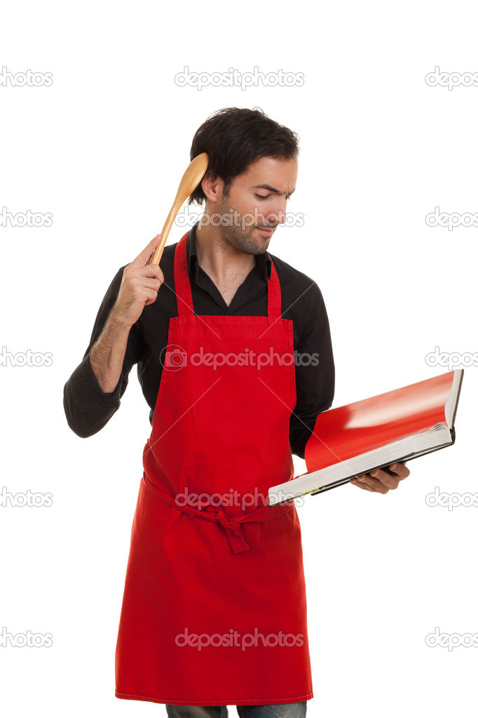 A thinking chef reading in a cookbook scratching his head with a spoon — Stock Photo #5916104