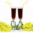 Two glass glasses with wine tubes for a cocktail and bouquets yellow field — Stock Photo