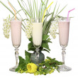 Glass glasses with a dairy cocktail and tubules on a white background with — Stock Photo