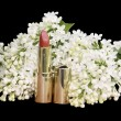 Female pink lipstick white flowers on a black background — Stock Photo #5768363