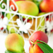 Stock Photo: Pears and peaches in basket