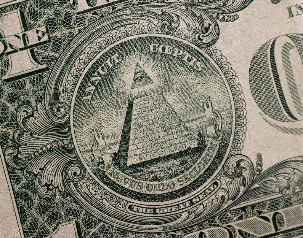 The pyramid and eye on the back of a one dollar bill.  Stock Photo #5391299