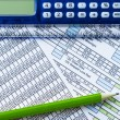 Calculator, pencil and data sheet - Stock Photo