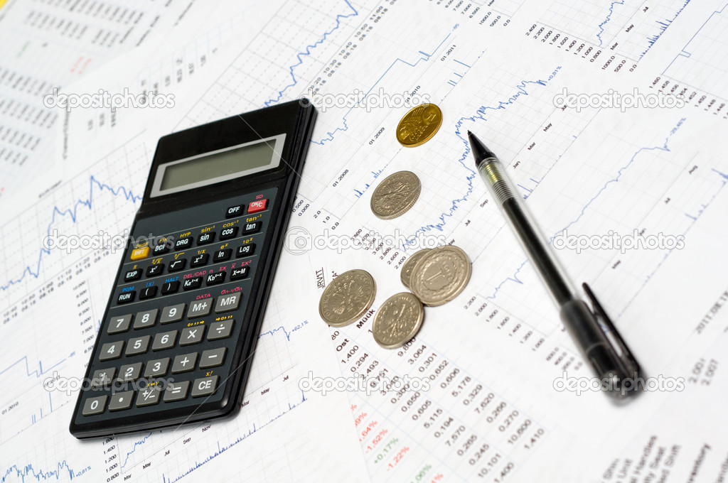 Calculator and coin's on the paper with financial graph's  Stock Photo #6441621