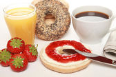 Breakfast with fresh bagels — Stock Photo