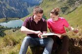 Male and female hikers in the Alps — Stock Photo