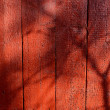 Royalty-Free Stock Photo: Shadows on red-painted wooden wall.