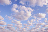 Sunny morning sky full of clouds. — Stock Photo